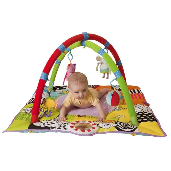 малыш в развивающем коврике с дугами